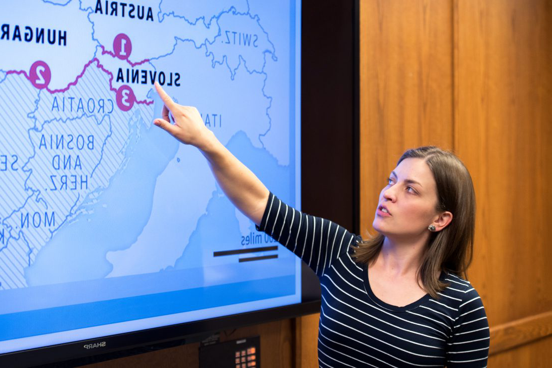 A social science student point to Slovenia on a map of Europe during a presentation
