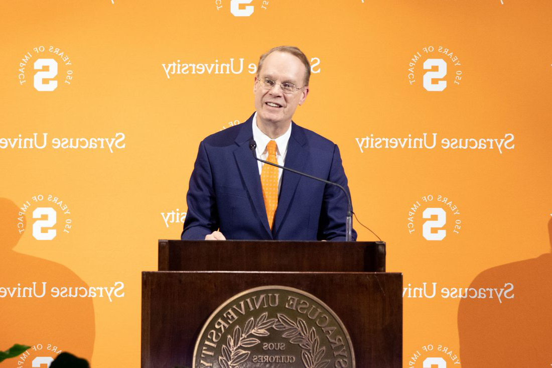 Chancellor Kent Syverud speaks at a podium