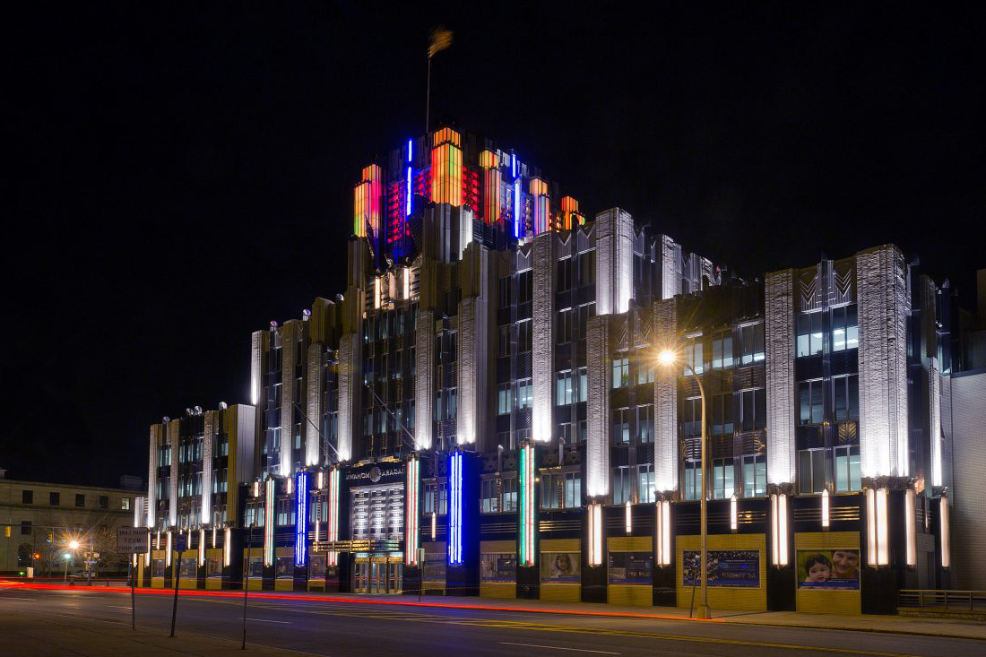 Syracuse's famous art deco Niagara Mohawk Building at night with its lights lit up in orange