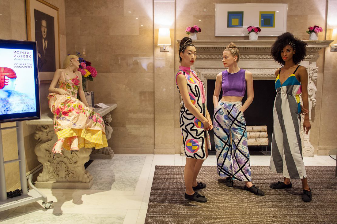 Models wear fashion students' designs at the Lubin House