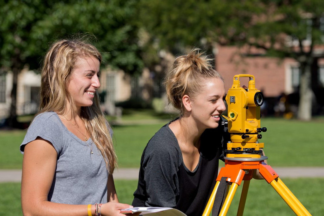 Civil engineering students surveying land on campus